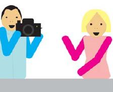 Fotograf robi zdjęcie kobiecie.