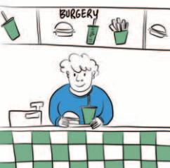 Pracownik restauracji typu fast food wydaje jedzenie.