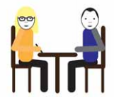 Dwie osoby siedzą przy stole, jedna notuje.