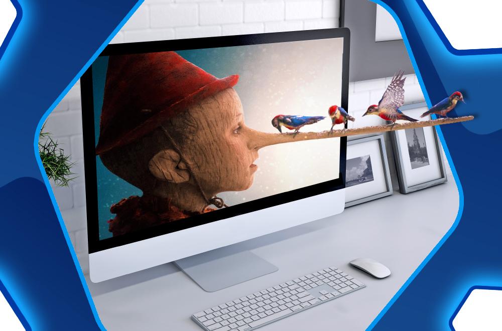 Z ekranu komputera wysuwa się nos Pinokia. Na nosie siedzą ptaki.