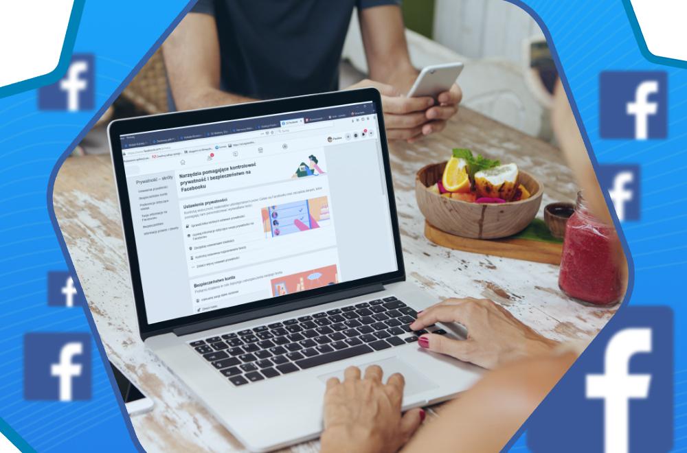 Otwarty laptop z wyświetloną stroną z ilustracjami i grafiką, dwie dłonie na klawiaturze