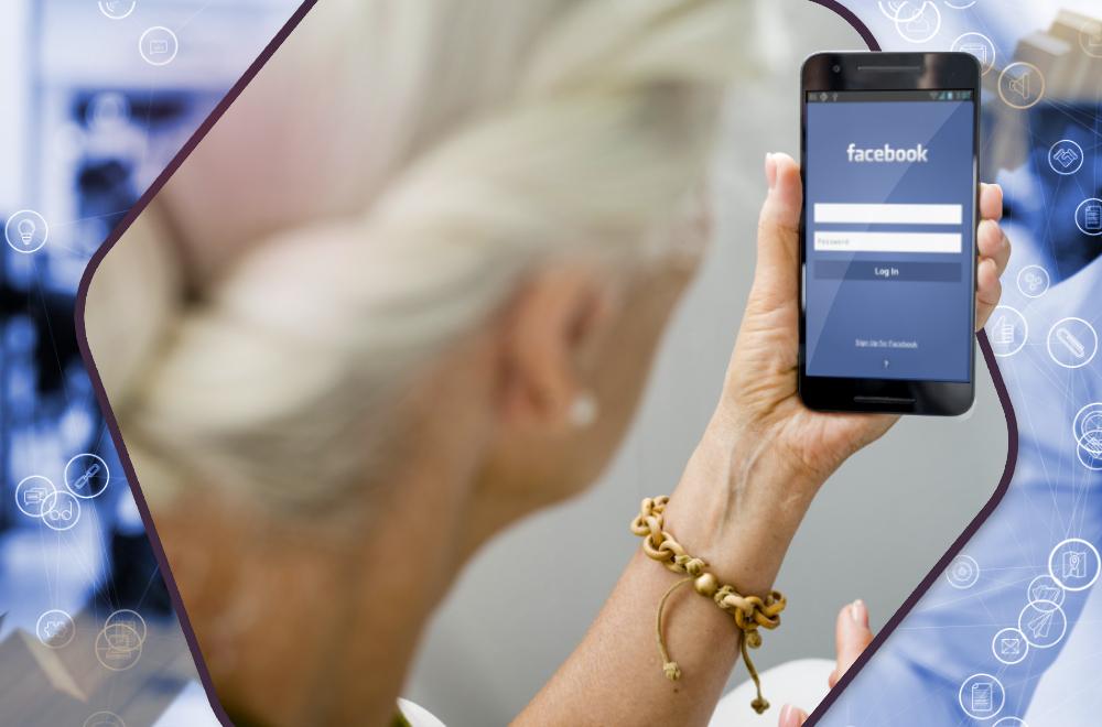 Osoba oglądająca portal Facebook na telefonie komórkowym,