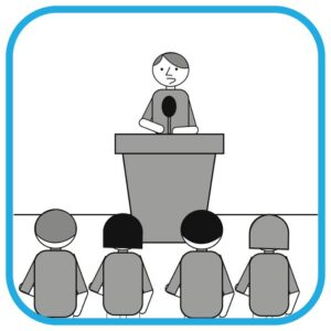 Osoba na mównicy. Przed nią rząd słuchaczy.